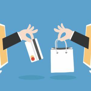 obrazek ukazuje dwa monitory w jednym karta kredytowa a w drugim zakupy